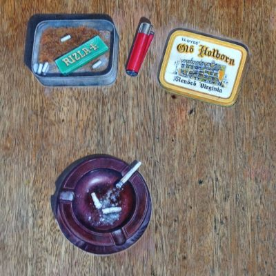 Ash tray and rollies trompe l'oeil on pub table